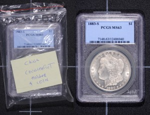 PCGS representatives showed Congressmen counterfeit U.S. coins in counterfeit PCGS holders during their recent meetings in Washington, DC.  (Photo courtesy of PCGS.)